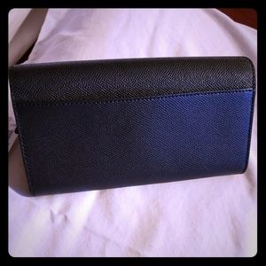 New black coach full size wallet.